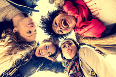 Four young beautiful girls smiling Stock Photos