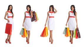 Four young brunette women holding shopping bags Royalty Free Stock Photography
