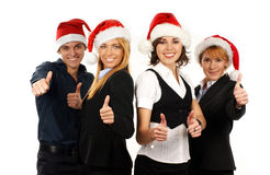 Four young business persons in Christmas hats Royalty Free Stock Photos