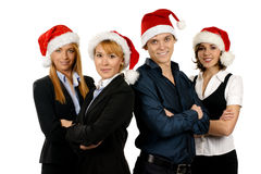 Four young business persons in Santa hats Royalty Free Stock Photo