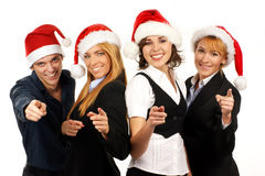 Four young business persons in Santa hats Stock Image