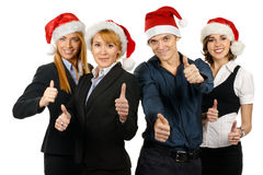 Four young businessperson in Christmas hats Royalty Free Stock Photo