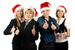 Four young businessperson in Christmas hats Stock Images
