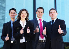 Four young businesspersons in formal clothes Stock Images