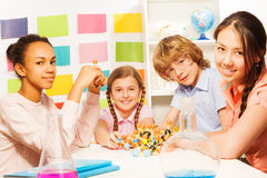 Four young chemists studying molecular structure Stock Images