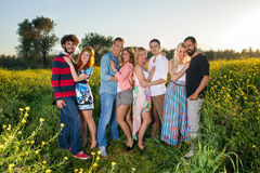 Four young couples in the country at sunset. Royalty Free Stock Photo