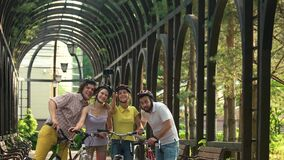 Four young cyclists taking selfie outdoors. stock footage
