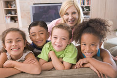 Four Young Friends Hanging Out At Home stock photography