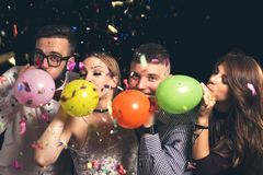Blowing balloons at New Year`s party stock photography