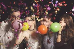 Blowing balloons Stock Photography