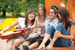 Four young  friends play the guitar Stock Photography