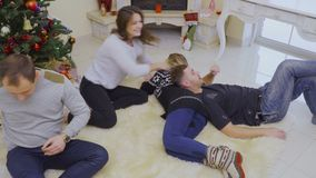 Four young friends relaxing at home together and celebrates Christmas stock video