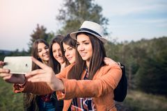 Group of four young women outdoors stock photography