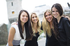 Four young good girl friend people in the city. A Four young good girl friend people in the city Royalty Free Stock Photos