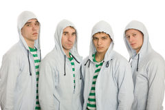 Four young guys Stock Images