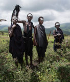 Four young Maasai boys who are coming of age to be junior warriors royalty free stock images