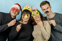 Four young men in festive masks Stock Photo