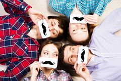 Four young men lie together Stock Photo