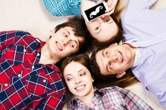 Four young men lie together Stock Images