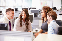 Four young office colleagues in a casual team meeting Royalty Free Stock Photos