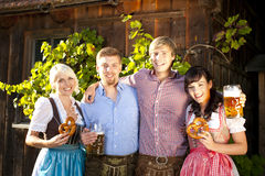 Four young people with beer glasses and bretzel Royalty Free Stock Image