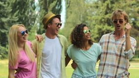 Four young people dancing from side to side and singing along at music festival. Stock footage stock video