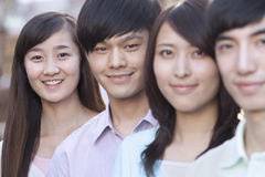 Four Young People Standing in a Row in Beijing Stock Image