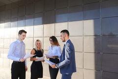 Four young people, two men and two women, students, communicate,. Four beautiful perspective people, two men and two women, young entrepreneurs, students stock photography