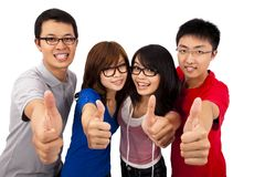 Four young teenagers and thumb up. Four young teenagers laughing and giving the thumbs-up