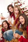 Four young woman having fun on Christmas Stock Photo