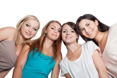 Four young woman looking down. Four attractive young women looking down at the camera with their heads close together isolated on white Stock Photos