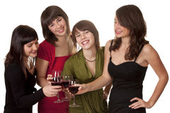 Four young women in evening wear Royalty Free Stock Photo
