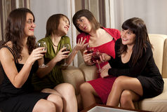 Four young women in evening wear Stock Images