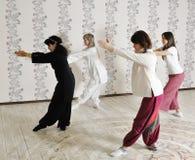 Four young women practice yoga Royalty Free Stock Photos