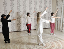 Four young women practice yoga Stock Image