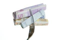 Fourchette avec de l'argent Photographie stock libre de droits