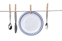 Fourchette, couteau, cuillère et plaque o Photographie stock