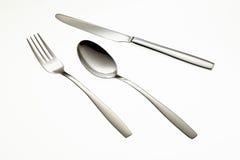 Fourchette, cuillère et couteau inoxydables Photographie stock libre de droits