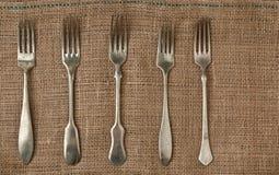 Fourchette de vintage sur un tissu rugueux Image libre de droits