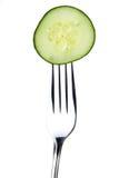 Fourchette et concombre Image stock