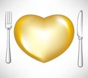 Fourchette et couteau avec le coeur d'or Photo stock