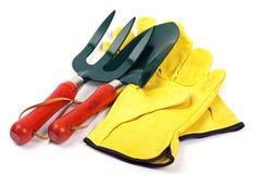 Fourchette et gants de truelle de jardin Image libre de droits
