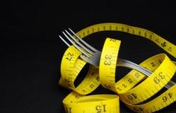 Fourchette et mètre, concept de régime Photos stock
