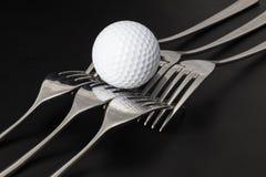 Fourchettes et boules de golf Photo stock