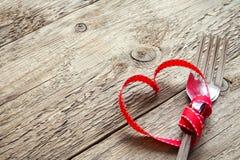 Fourchettes et coeur rouge Photographie stock libre de droits