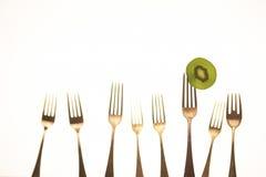 Fourchettes et kiwi Image stock