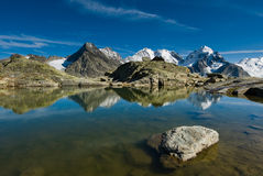 Fourcla Surlej. Mountain lake at Fourcla Surlej, Engadin, Switzerland. View of Piz Rosegg and Piz Bernina Royalty Free Stock Photo