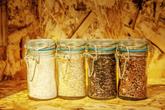 Foure race of rice varieties in glass: brown rice, mixed wild ri Stock Photo