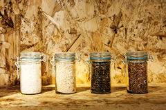 Foure race of rice varieties in glass: brown rice, mixed wild ri Stock Photos
