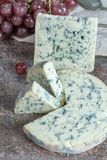 Fourme Ambert and Blue Auvergne semi-hard AOP French blue cheeses made from raw cow milk in Auvergne, France. Pieces of Fourme Ambert and Blue Auvergne semi-hard stock photography